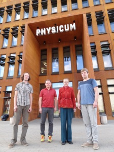 The authors in front of the building of the Institute of Physics, University of Tartu, Estonia: doctoral students Mihkel Rünkla (far left), Ott Vilson (far right), senior researcher Margus Saal (center left), head of the Laboratory of Theoretical Physics Piret Kuusk (center right).