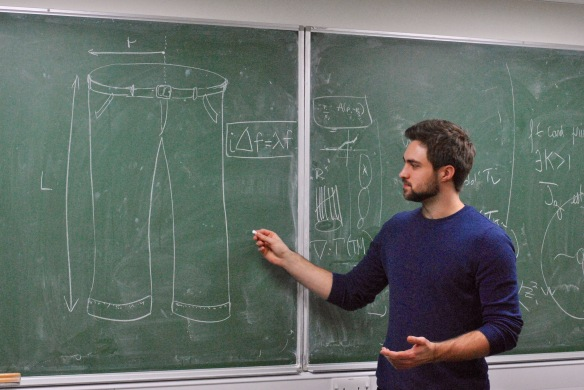 One of the authors, Ian Jubb, discussing a pair of trousers with his colleagues at Imperial College London. Ian Jubb is currently the PhD student of Fay Dowker at Imperial College London.